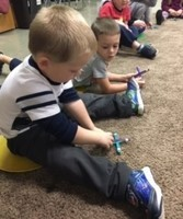 Four year olds enjoying STEM activity