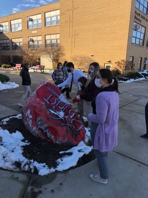 Students painting rock