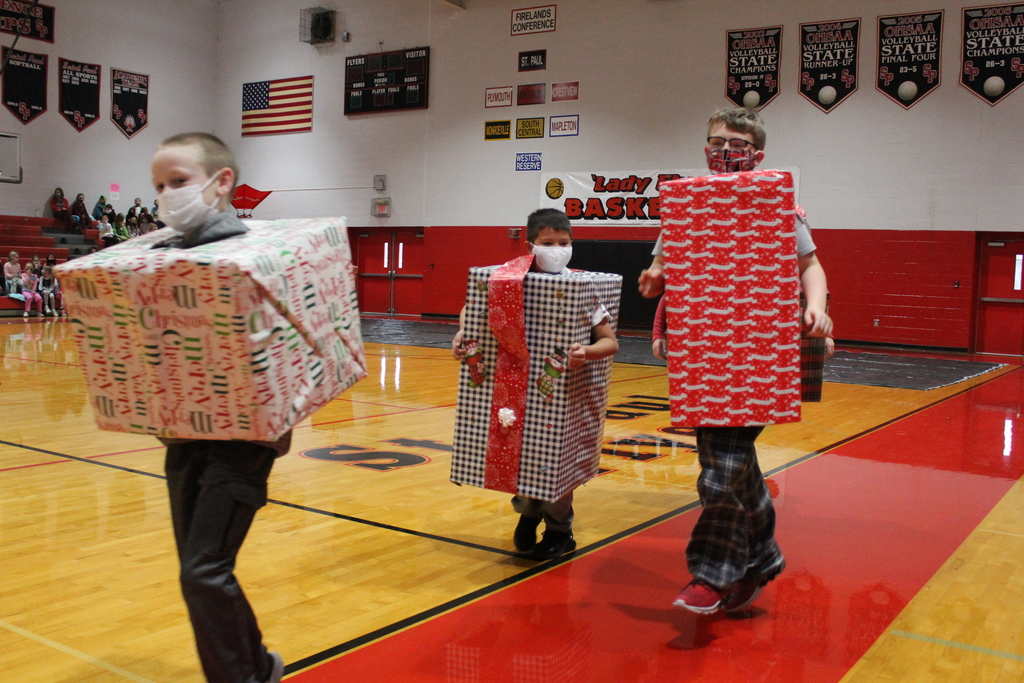 kids dressed as presents