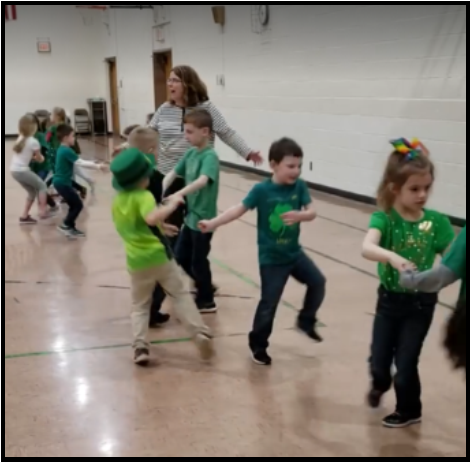 Kindergartners doing an Irish Dance