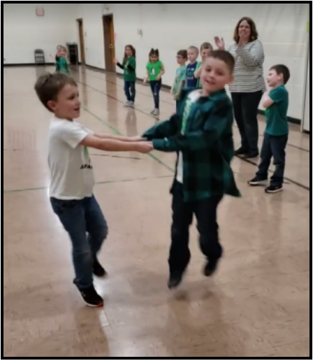 Kindergartners doing an Irish dance.