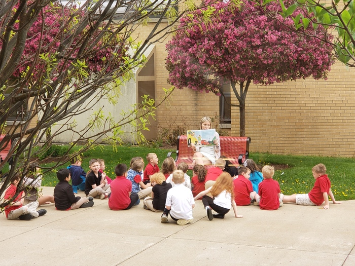The First Graders having outside story time.